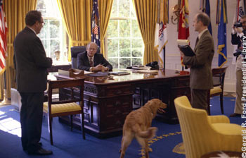President Ford confers with Secretary of State Henry Kissinger and National Security Advisor Brent Scowcroft in the Oval Office. October 8, 1974.