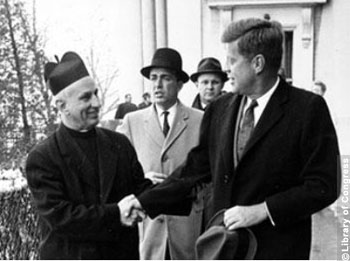 Inauguration Day: John F. Kennedy Shakes hands with Father Richard J. Casey after attending Mass at Holy Trinity Church.