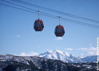 Passengers on the Iron Mountain Tramway at Glenwood Caverns Adventure Park in Glenwood Springs, Colo., enjoy views of snowy Mt. Sopris and surrounding Rocky Mountains.