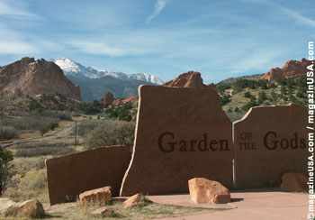 Pikes Peak makes the backdrop while standing in the Garden of the Gods Park.
