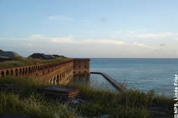 View of Fort Jefferson moat and walls from elevated terreplain around the Fort