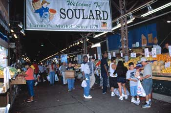 Fresh vegetables and fruits, spices and plants, and generations of family farmers fill the stalls at historic Soulard Farmers' Market - in continuous operation since 1779 in St. Louis.