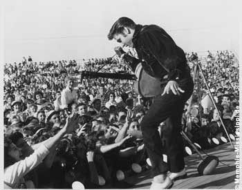 Elvis Presely on stage in Tupelo 1957