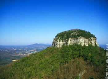 Pilot Mountain, rising more than 1,400 feet above the rolling countryside of the upper Piedmont plateau, was dedicated as a National Natural Landmark in 1976 and is the centerpiece of Pilot Mountain State Park.