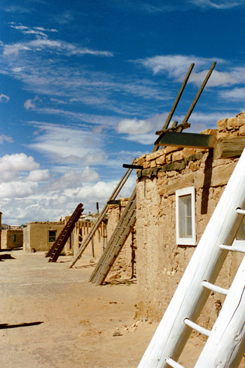 Acoma Pueblo sits atop a 376 ft mesa overlooking the desert. Acoma is the oldest continuously inhabited community in the United States.