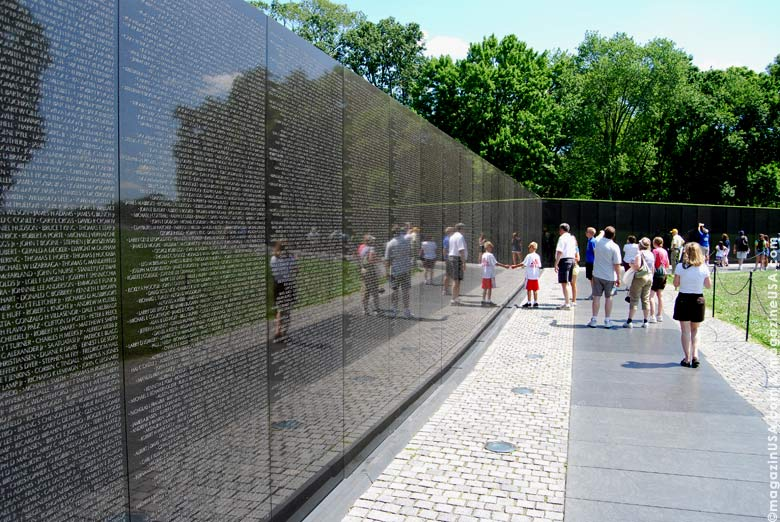 The black granite wall are inscribed with the names of the 58,209 Americans missing or killed in the Vietnam conflict.